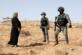 Palestinian woman defends her land